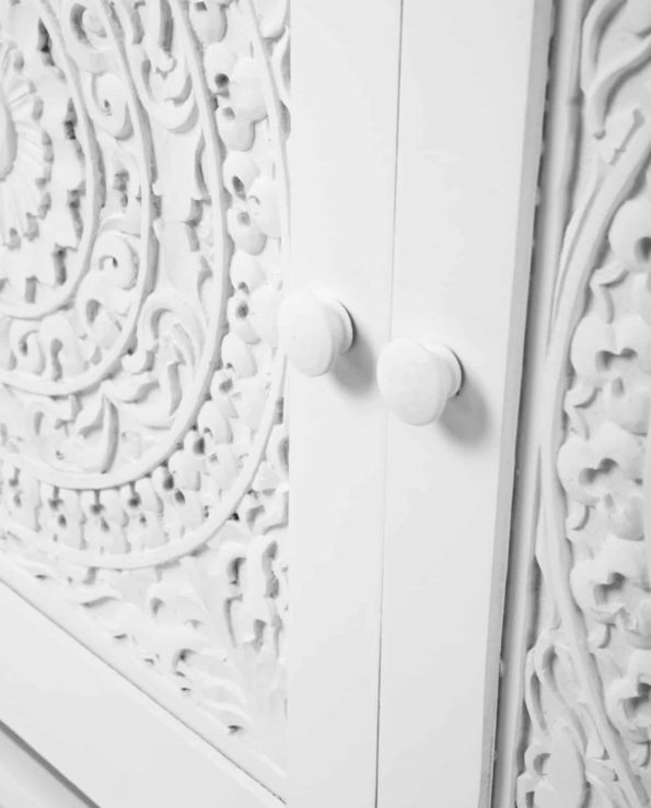 White carved cabinet closeup